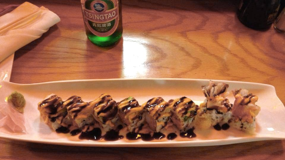 A special Hartsville Roll sushi roll and Tsingtao beer at Golden Dragon II in Downtown Hartsville.