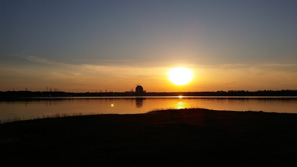The sun sets across the lake from Johnson's Landing.