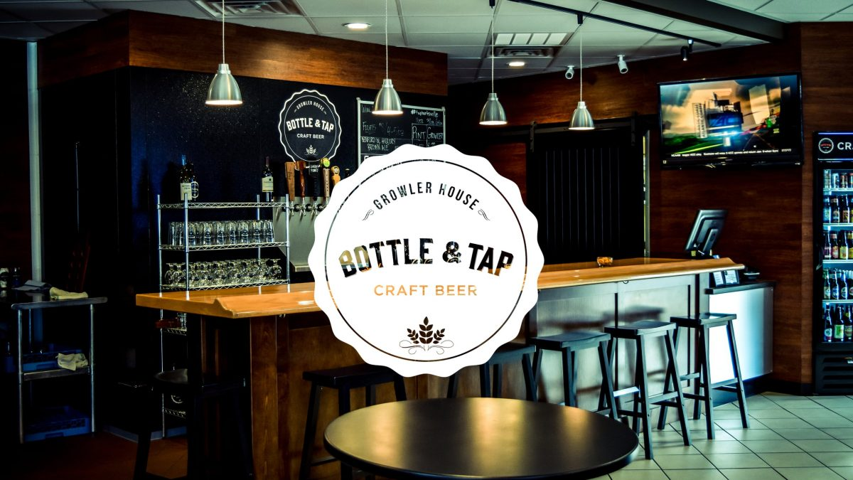 The Bottle & Tap logo overplayed on a photo of their bar.