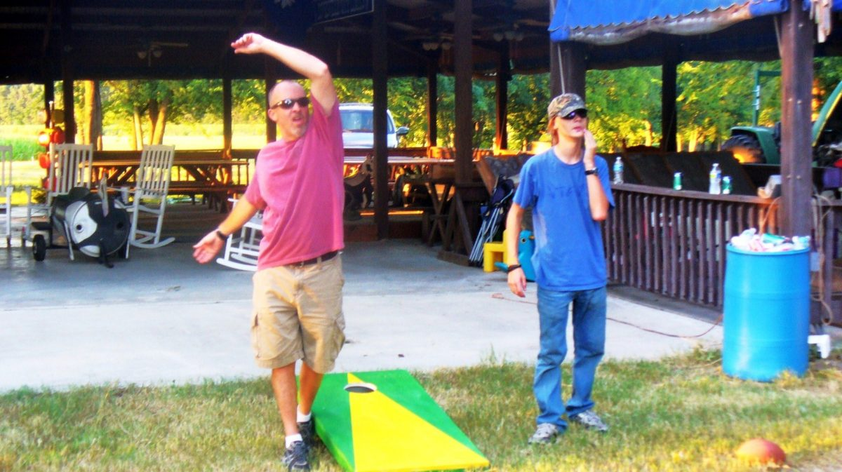 Visitors play corn hole at Pim Farms.