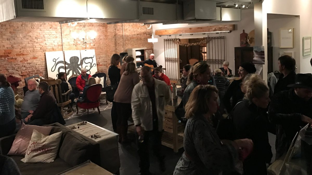 Guests enjoy drinks and comfortable furniture with live music in the background at Retrofit sip-n-seat.