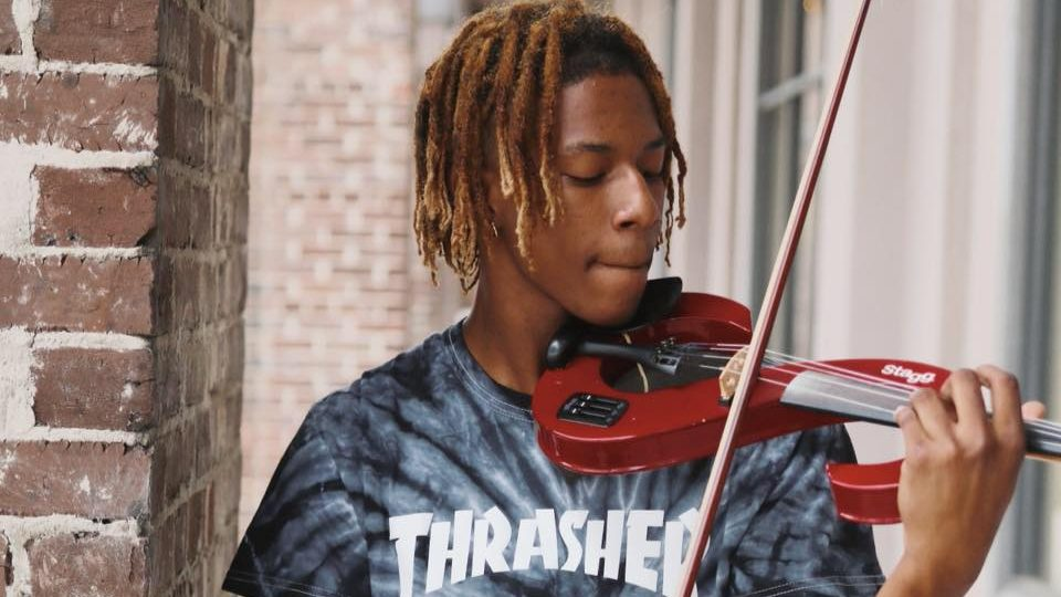 Local violinist Te'Quan Coe with his instrument.