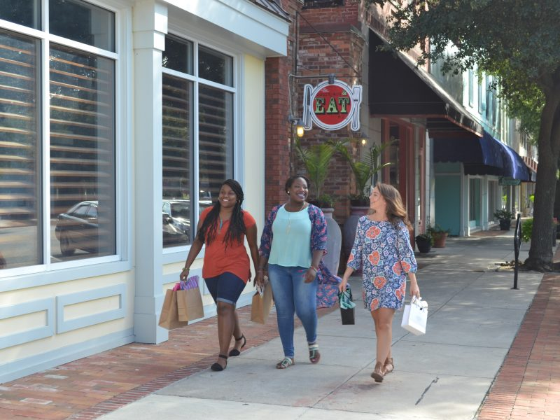 Three women can't stop smiling as they walk through Downtown Hartsville from store to store.