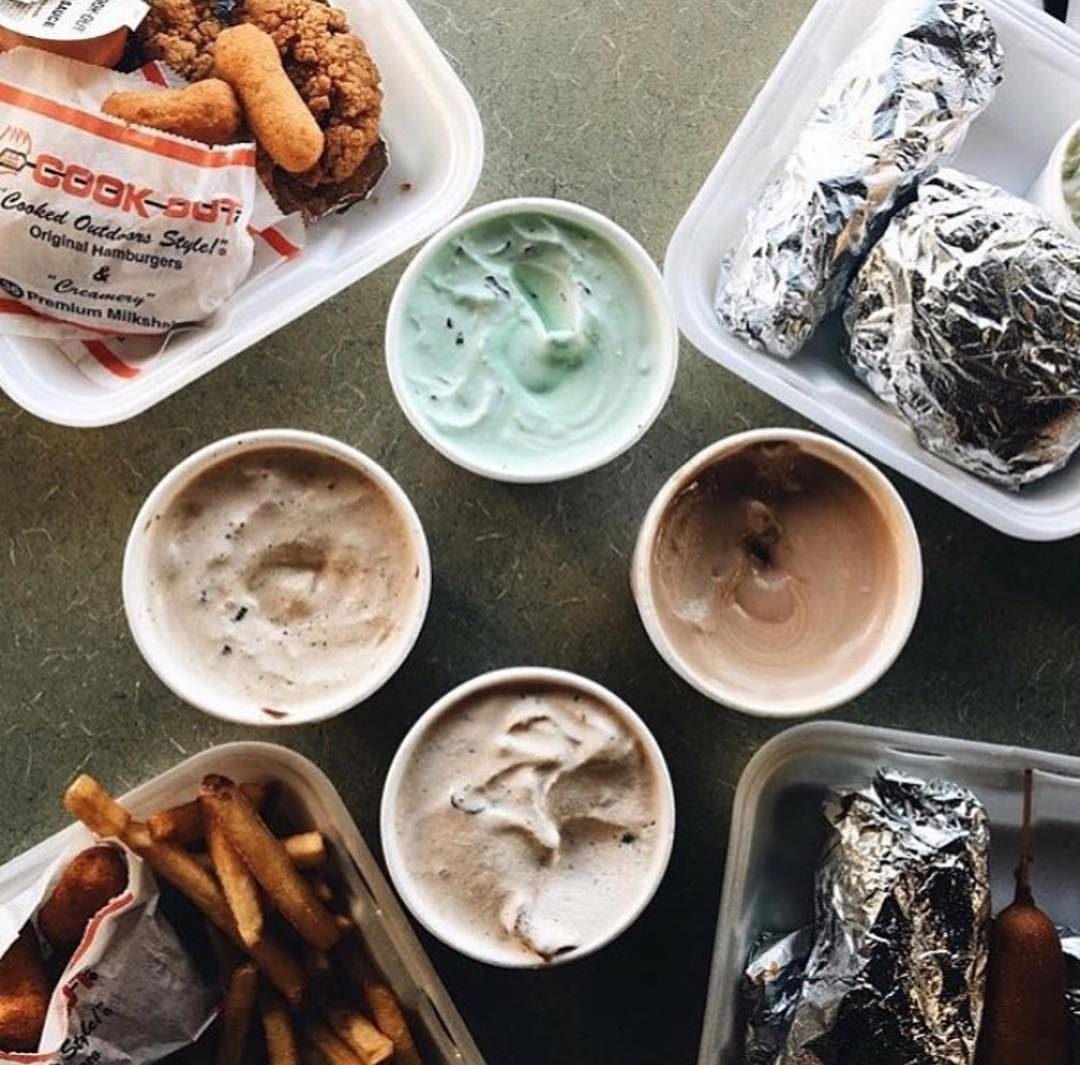 Assorted food and milkshakes from Cook Out.