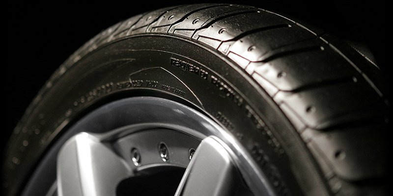 A new tire mounted on an alloy wheel.