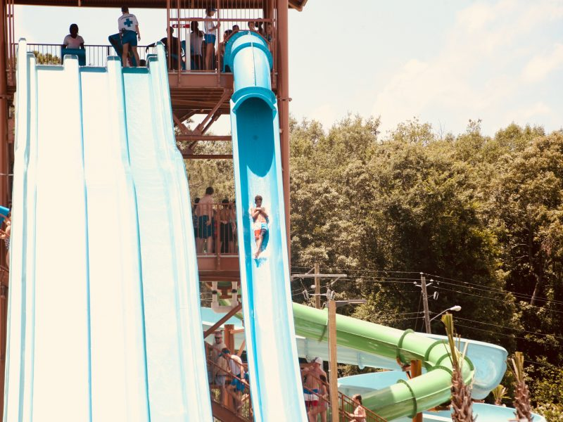 A guest zips down the Neptune's Revenge speed slide at Neptune Island in Hartsville.