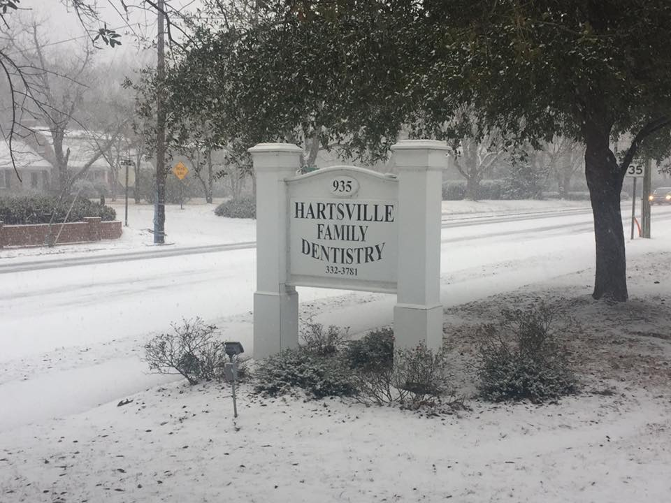 Snowfall around the Hartsville Family Dentistry sign in Jan 2018.