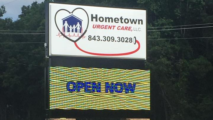The sign outside of Hometown Urgent Care.