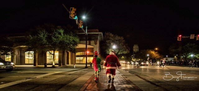Mr & Mrs Claus walk through Downtown Hartsville enjoying the sights and sounds of Christmas on Carolina.