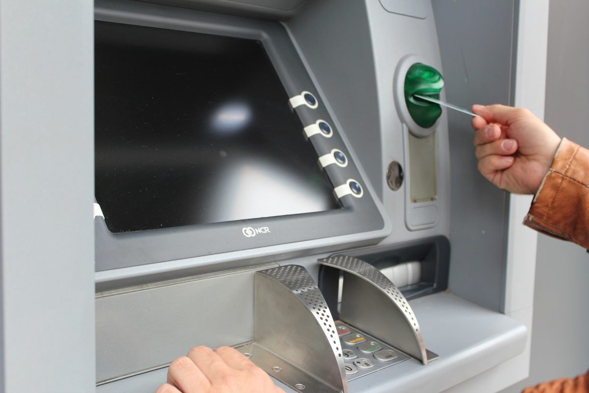 An example of someone using a walk-up ATM.