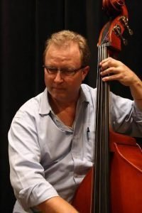 Andy Preston performing with his stand-up bass.