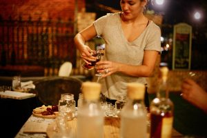 Brandy pours select bourbons at a Retrofit sip-n-seat tasting event.
