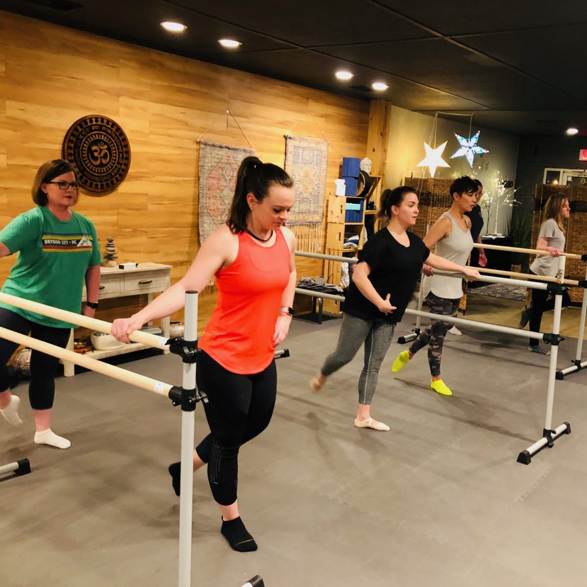 Customers in a barre pilates class at Flex Fitness